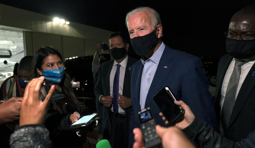 Democratic presidential candidate former Vice President Joe Biden speaks to media as he arrives at New Castle Airport, in New Castle, Del., Wednesday, Sept. 23, 2020, as he returns Charlotte, N.C. (AP Photo/Carolyn Kaster)
