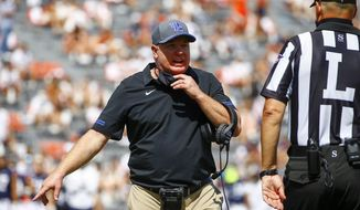 Kentucky head coach Mark Stoops reacts to a call during the second quarter of an NCAA college football game against Auburn on Saturday, Sept. 26, 2020, in Auburn, Ala. (AP Photo/Butch Dill)