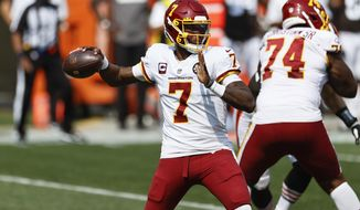 Washington Football Team quarterback Dwayne Haskins looks to throw against the Cleveland Browns during the first half of an NFL football game, Sunday, Sept. 27, 2020, in Cleveland. (AP Photo/Ron Schwane)