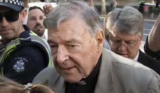 In this Feb. 27, 2019, file photo, Cardinal George Pell arrives at the County Court in Melbourne, Australia. Pell, Pope Francis' former finance minister, will soon return to the Vatican during an extraordinary economic scandal for the first time since he was cleared of child abuse allegations in Australia five months ago, a newspaper has reported, Monday, Sept. 28, 2020. (AP Photo/Andy Brownbill, File)