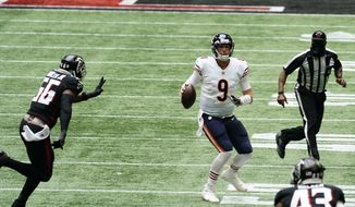 Chicago Bears quarterback Nick Foles (9) works against the Atlanta Falcons during the second half of an NFL football game, Sunday, Sept. 27, 2020, in Atlanta. (AP Photo/Brynn Anderson)