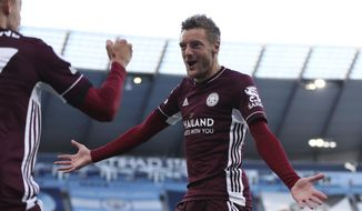 Leicester's Jamie Vardy right, celebrates after scoring his sides second goal of the game with teammate Leicester's Timothy Castagne during the English Premier League soccer match between Manchester City and Leicester City at the Etihad stadium in Manchester, England, Sunday, Sept. 27, 2020. (Catherine Ivill/Pool via AP)