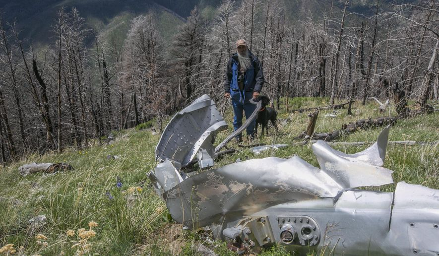"""FILE - This June 2016, file photo shows wreckage from a U.S. Air Force that bomber crashed on Emigrant Peak in southwestern Montana on July 23, 1962, killing four men during a training run. The wreckage still remains on a remote section of the peak. Emigrant, Montana resident Bryan Wells, has succeeded in his efforts to create a memorial for the men who died. The U.S. House of Representatives on Sept. 21, 2020, passed a bill naming the crash site as """"B-47 Ridge."""" The U.S. Senate has already passed the bill and it is awaiting the signature of President Donald Trump.(Adrian Sanchez-Gonzalez/Bozeman Daily Chronicle via AP, FILE)"""