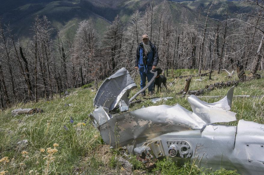 "FILE - This June 2016, file photo shows wreckage from a U.S. Air Force that bomber crashed on Emigrant Peak in southwestern Montana on July 23, 1962, killing four men during a training run. The wreckage still remains on a remote section of the peak. Emigrant, Montana resident Bryan Wells, has succeeded in his efforts to create a memorial for the men who died. The U.S. House of Representatives on Sept. 21, 2020, passed a bill naming the crash site as ""B-47 Ridge."" The U.S. Senate has already passed the bill and it is awaiting the signature of President Donald Trump.(Adrian Sanchez-Gonzalez/Bozeman Daily Chronicle via AP, FILE)"