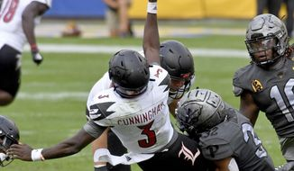 Pittsburgh linebacker SirVocea Dennis takes down Louisville quarterback Malik Cunningham as he gets a pass off in the fourth quarter during an NCAA college football game at Heinz Field, Saturday, Sept. 26, 2020, in Pittsburgh. (Matt Freed/Pittsburgh Post-Gazette via AP)