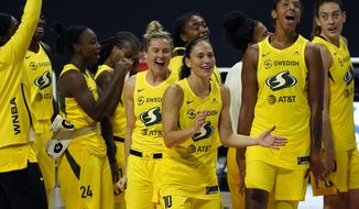 The Seattle Storm celebrate after the team defeated the Minnesota Lynx during Game 3 of a WNBA basketball semifinal round playoff series Sunday, Sept. 27, 2020, in Bradenton, Fla. The Storm move onto the WNBA finals. (AP Photo/Chris O'Meara)
