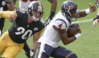 Houston Texans quarterback Deshaun Watson (4) gets away from Pittsburgh Steelers outside linebacker T.J. Watt (90) during the first half of an NFL football game, Sunday, Sept. 27, 2020, in Pittsburgh. (AP Photo/Don Wright)