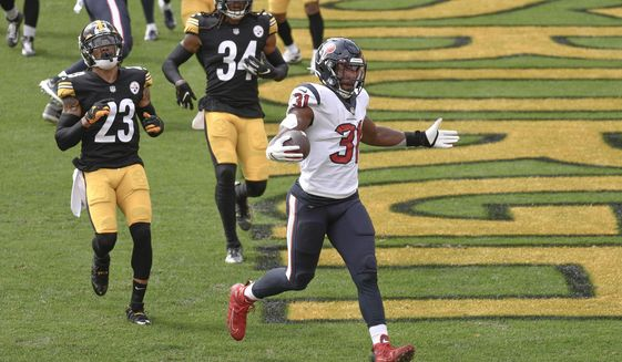 Houston Texans running back David Johnson (31) celebrates after scoring a touchdown against the Pittsburgh Steelers during the first half of an NFL football game, Sunday, Sept. 27, 2020, in Pittsburgh. (AP Photo/Don Wright)