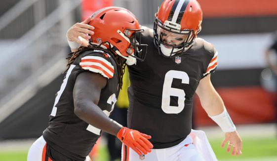 Cleveland Browns quarterback Baker Mayfield (6) congratulates running back Kareem Hunt after Hunt scored on a 9-yard touchdown pass during the first half of an NFL football game against the Washington Football Team, Sunday, Sept. 27, 2020, in Cleveland. (AP Photo/David Richard)