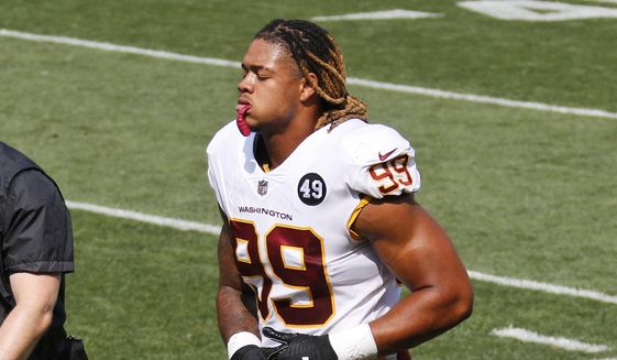 Washington Football Team defensive end Chase Young limps back to the locker room during the first half of an NFL football game against the Cleveland Browns, Sunday, Sept. 27, 2020, in Cleveland. (AP Photo/Ron Schwane)