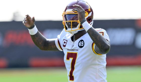 Washington Football Team quarterback Dwayne Haskins celebrates after a 2-yard rushing touchdown by running back Antonio Gibson during the second half of an NFL football game against the Cleveland Browns, Sunday, Sept. 27, 2020, in Cleveland. (AP Photo/David Richard)