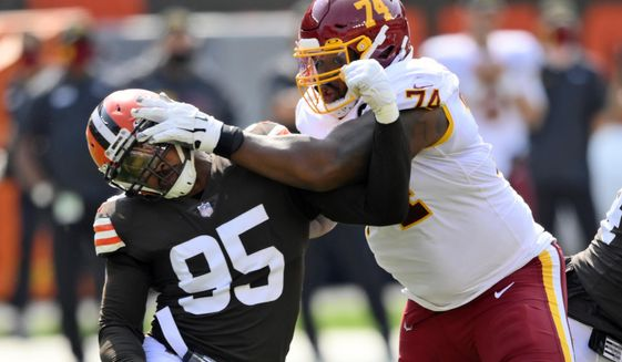 Cleveland Browns defensive end Myles Garrett (95) tries to get past Washington Football Team offensive tackle Geron Christian (74) during the first half of an NFL football game, Sunday, Sept. 27, 2020, in Cleveland. (AP Photo/David Richard)