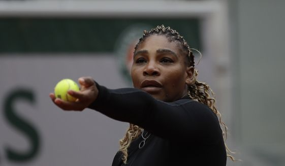 Serena Williams of the U.S. serves against Kristie Ahn of the U.S. in the first round match of the French Open tennis tournament at the Roland Garros stadium in Paris, France, Monday, Sept. 28, 2020. (AP Photo/Alessandra Tarantino)