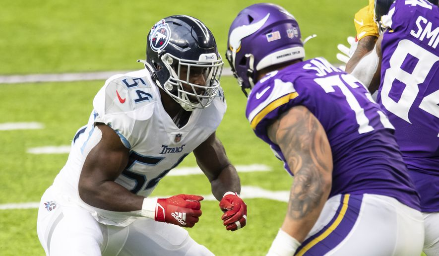 Tennessee Titans linebacker Rashaan Evans (54) competes against Minnesota Vikings guard Dru Samia (73) in the third quarter during an NFL football game, Sunday, Sept. 27, 2020, in Minneapolis. The Titans defeated the Vikings 31-30. (AP Photo/David Berding)
