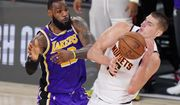 Los Angeles Lakers' LeBron James (23) and Denver Nuggets' Nikola Jokic (15) battle for the ball during the second half of an NBA conference final playoff basketball game Saturday, Sept. 26, 2020, in Lake Buena Vista, Fla. The Lakers won 117-107 to win the series 4-1. (AP Photo/Mark J. Terrill) **FILE**
