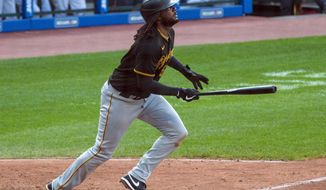 Pittsburgh Pirates' Josh Bell watches his flyout to right field to end a baseball game against the Cleveland Indians in Cleveland, Sunday, Sept. 27, 2020. (AP Photo/Phil Long)