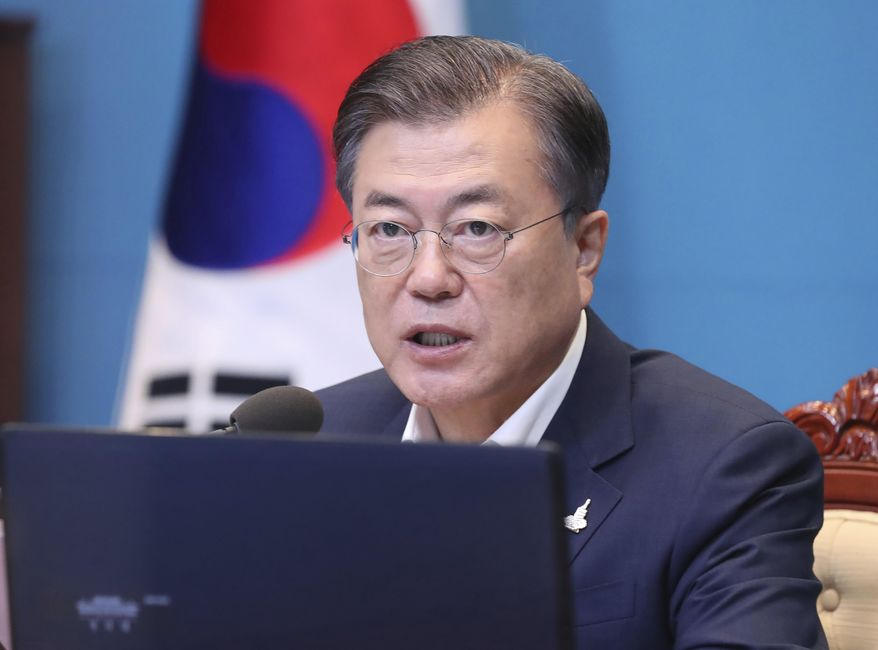 South Korean President Moon Jae-in speaks during a meeting with his senior secretaries at the presidential Blue House in Seoul, South Korea, Monday, Sept. 28, 2020. (Lee Jin-wook/Yonhap via AP)
