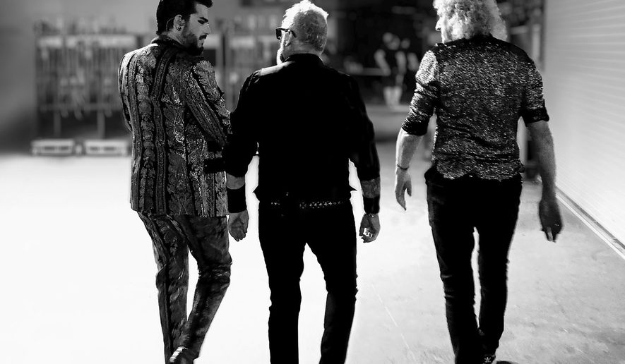 """This album cover image released by Hollywood Records shows """"Live Around the World"""" by Queen + Adam Lambert, releasing Friday, Oct. 2. (Hollywood Records via AP)"""