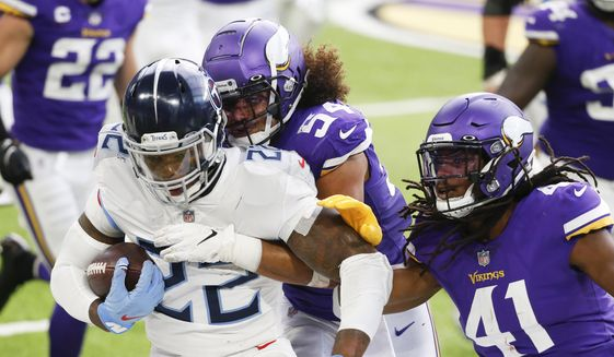 Tennessee Titans running back Derrick Henry (22) is tackled by Minnesota Vikings middle linebacker Eric Kendricks (54) and free safety Anthony Harris (41) during the first half of an NFL football game, Sunday, Sept. 27, 2020, in Minneapolis. (AP Photo/Bruce Kluckhohn)  **FILE**