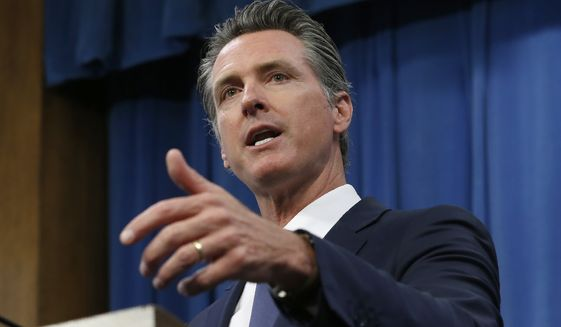 In this July 23, 2019, file photo, Gov. Gavin Newsom talks to reporters at his Capitol office in Sacramento, Calif. Newsom has vetoed a bill that would have authorized California to give low-income immigrants $600 to buy groceries. (AP Photo/Rich Pedroncelli, File)