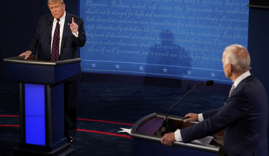 President Donald Trump makes a point as Democratic presidential candidate former Vice President Joe Biden looks on during the first presidential debate Tuesday, Sept. 29, 2020, at Case Western University and Cleveland Clinic, in Cleveland, Ohio. (AP Photo/Morry Gash, Pool)