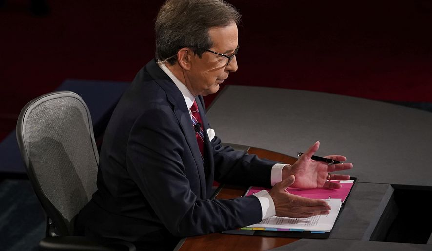 Moderator Chris Wallace of Fox News talks before the first presidential debate Tuesday, Sept. 29, 2020, at Case Western University and Cleveland Clinic, in Cleveland, Ohio. (AP Photo/Morry Gash, Pool)