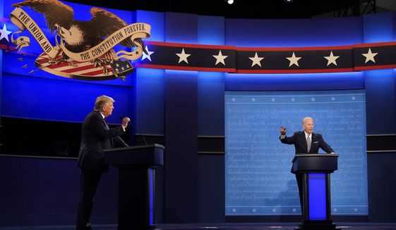 President Donald Trump, left, and Democratic presidential candidate former Vice President Joe Biden, right, during the first presidential debate Tuesday, Sept. 29, 2020, at Case Western University and Cleveland Clinic, in Cleveland, Ohio. (AP Photo/Julio Cortez)