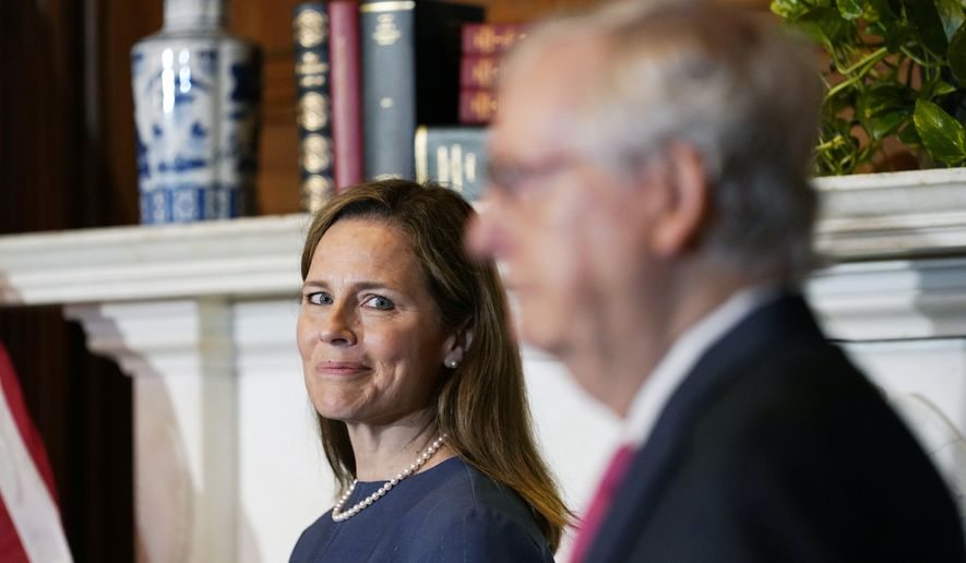 Senate Majority Leader Mitch McConnell of Ky., meets with Supreme Court nominee Judge Amy Coney Barrett on Capitol Hill in Washington, Tuesday, Sept. 29, 2020. (AP Photo/Susan Walsh, POOL)