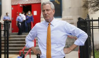 In this Aug. 19, 2020, file photo, New York Mayor Bill de Blasio addresses the media in New York. De Blasio said on Tuesday, Sept. 29, 2020, that he was sending teams of hundreds outreach workers and contact tracers to nine Brooklyn and Queens ZIP codes that have seen an upswing in positive COVID-19 tests in hopes of avoiding harsher enforcement measures.(AP Photo/John Minchillo, File)