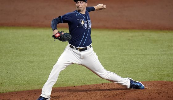 Tampa Bay Rays' Blake Snell pitches to the Toronto Blue Jays during the third inning of Game 1 of a wild card playoff series baseball game Tuesday, Sept. 29, 2020, in St. Petersburg, Fla. (AP Photo/Chris O'Meara)