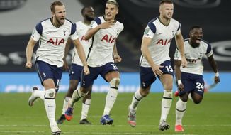 Tottenham players celebrate during the English League Cup fourth round soccer match between Tottenham Hotspur and Chelsea at Tottenham Hotspur Stadium in London, England, Tuesday, Sept. 29, 2020.Tottenham defeated Chelsea 5-4 on penalties. (Matt Dunham/Pool via AP)