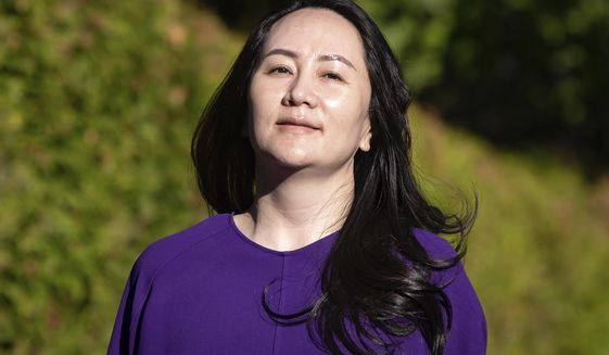 Meng Wanzhou, chief financial officer of Huawei, leaves her home to attend a court hearing in Vancouver, British Columbia, on Tuesday, Sept. 29, 2020. (Darryl Dyck/The Canadian Press via AP)