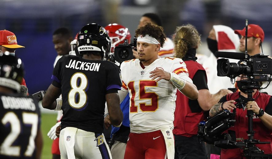Baltimore Ravens quarterback Lamar Jackson (8) and Kansas City Chiefs quarterback Patrick Mahomes (15) embrace after an NFL football game Monday, Sept. 28, 2020, in Baltimore. The Chiefs won 34-20. (AP Photo/Gail Burton)  **FILE**