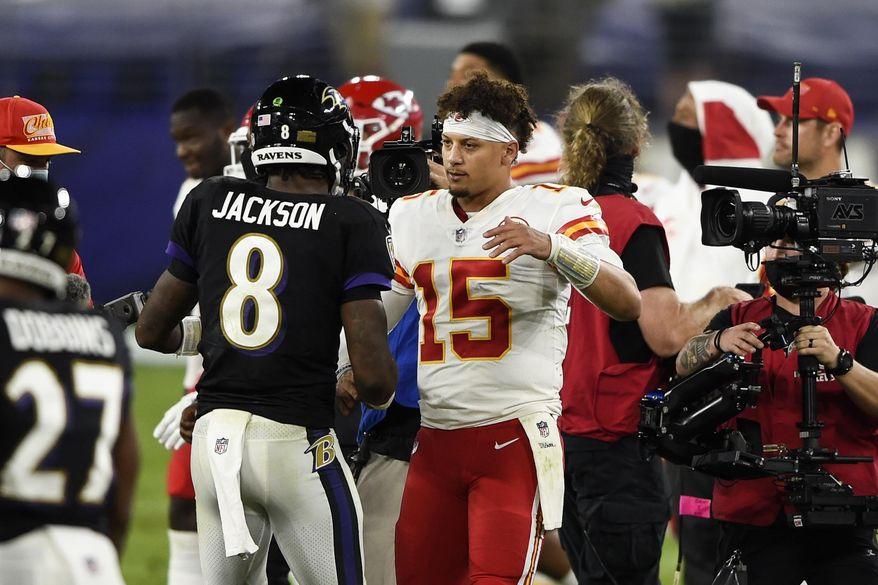 Baltimore Ravens quarterback Lamar Jackson (8) and Kansas City Chiefs quarterback Patrick Mahomes (15) embrace after an NFL football game Monday, Sept. 28, 2020, in Baltimore. The Chiefs won 34-20. (AP Photo/Gail Burton)  **FILE**