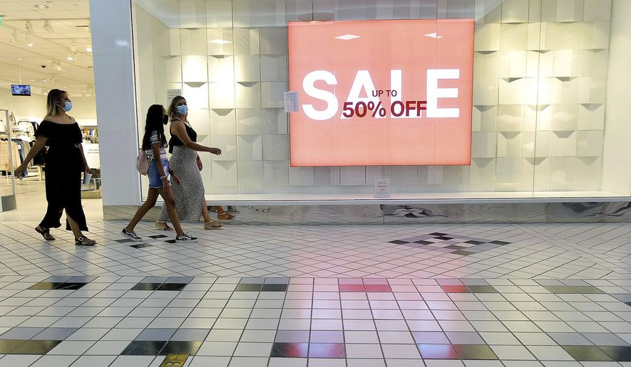 In this Aug. 11, 2020, file photo, shoppers walk through the Valley Mall in Halfway, Md. (Colleen McGrath/The Herald-Mail via AP, File)