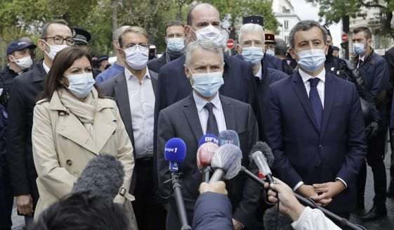 From the left, Paris mayor Anne Hidalgo, anti-terrorism state prosecutor Jean-Francois Ricard , and Interior Minister Gerald Darmanin answer reporters after a knife attack near the former offices of satirical newspaper Charlie Hebdo, Friday Sept. 25, 2020 in Paris. French terrorism authorities are investigating a stabbing of two people outside the former offices of the satirical newspaper Charlie Hebdo in Paris, and two suspects have been arrested, authorities said. (AP Photo/Lewis Joly)
