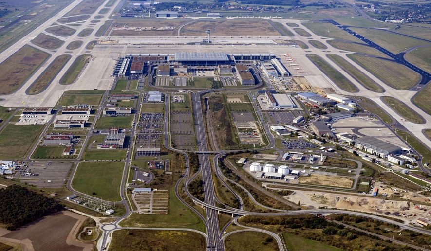 "File--- File picture taken Sept. 15, 2020 shows aerial view of the future airport Berlin Brandenburg ""Willy Brandt"" in Schoenefeld, Germany, After several cancelled dates, the new Capital Airport BER is planned to open on Oct. 31.  (Soeren Stache/dpa via AP, File)"