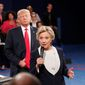 Democratic presidential nominee Hillary Clinton, right, speaks as Republican presidential nominee Donald Trump listens during the second presidential debate at Washington University in St. Louis, Sunday, Oct. 9, 2016. (Rick T. Wilking/Pool via AP) **FILE**