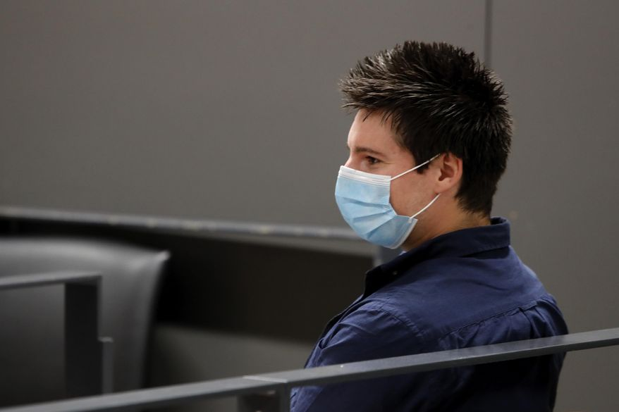 Portuguese hacker Rui Pinto sits in the courtroom at the start of his trial in Lisbon, Friday, Sept. 4, 2020. Lisbon court is hearing the case against 31-year-old Pinto, whose explose was published over financial revelations about European soccer players, top clubs, influential agents and continental officials. (AP Photo/Armando Franca)