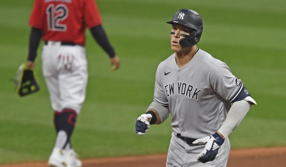 New York Yankees' Aaron Judge (99) runs the bases after hitting a two run home run off Cleveland Indians starting pitcher Shane Bieber (57) in the first inning of Game 1 of an American League wild-card baseball series, Tuesday, Sept. 29, 2020, in Cleveland. (AP Photo/David Dermer)
