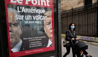 """The front page of French weekly newspaper Le Point displays a photo of President Trump and Democratic presidential candidate Joseph R. Biden with a headline reading """"America on a volcano, (and Us too)"""" in Paris. (ASSOCIATED PRESS)"""