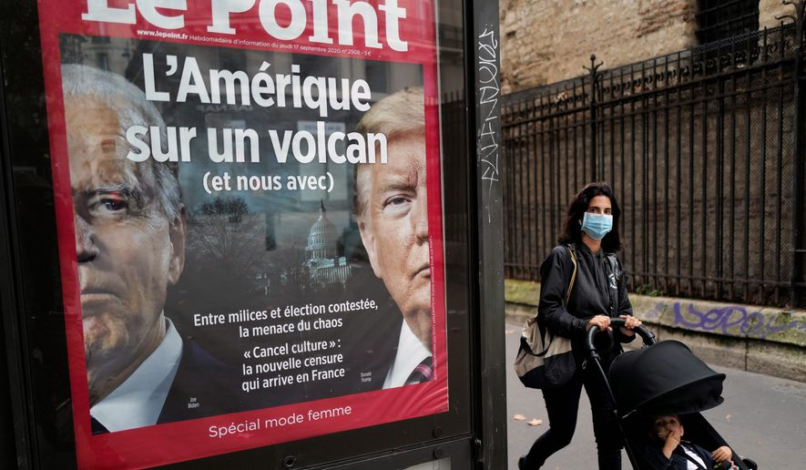 "The front page of French weekly newspaper Le Point displays a photo of President Trump and Democratic presidential candidate Joseph R. Biden with a headline reading ""America on a volcano, (and Us too)"" in Paris. (ASSOCIATED PRESS)"