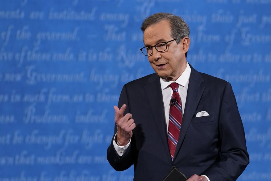 Moderator Chris Wallace of Fox News speaking on stage before the start of the first presidential debate Tuesday, Sept. 29, 2020, at Case Western University and Cleveland Clinic, in Cleveland, Ohio. (AP Photo/Patrick Semansky)