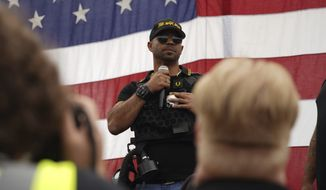 Proud Boys leader Enrique Tarrio speaks to supporters at a rally in Delta Park on Saturday, Sept. 26, 2020, in Portland, Ore. (AP Photo/Allison Dinner)