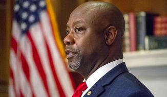 In this file photo, Sen. Tim Scott, R-S.C., meets with Judge Amy Coney Barrett, President Donald Trumps nominee for the U.S. Supreme Court, not shown, on Capitol Hill in Washington, Wednesday, Sept. 30, 2020. [Photo credit: Bonnie Cash] **FILE**