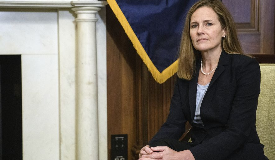Judge Amy Coney Barrett, President Donald Trumps nominee for the U.S. Supreme Court, meets with Sen. John Cornyn, R-Texas, not pictured, on Capitol Hill in Washington, Wednesday, Sept. 30, 2020. (Nicholas Kamm/Pool via AP)