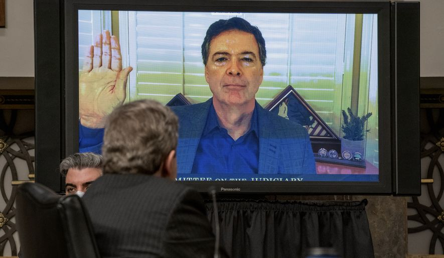 "Former FBI director James Comey is sworn via videoconference before testifying during a Senate Judiciary Committee hearing on Capitol Hill in Washington, Wednesday, Sept. 30, 2020, to examine the FBI ""Crossfire Hurricane"" investigation. (Ken Cedeno/Pool via AP)"