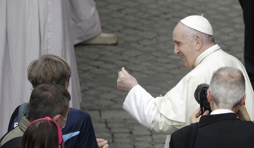 Pope Francis greets faithful during his weekly general audience in the St. Damaso courtyard at the Vatican, Wednesday, Sept. 30, 2020. (AP Photo/Gregorio Borgia)