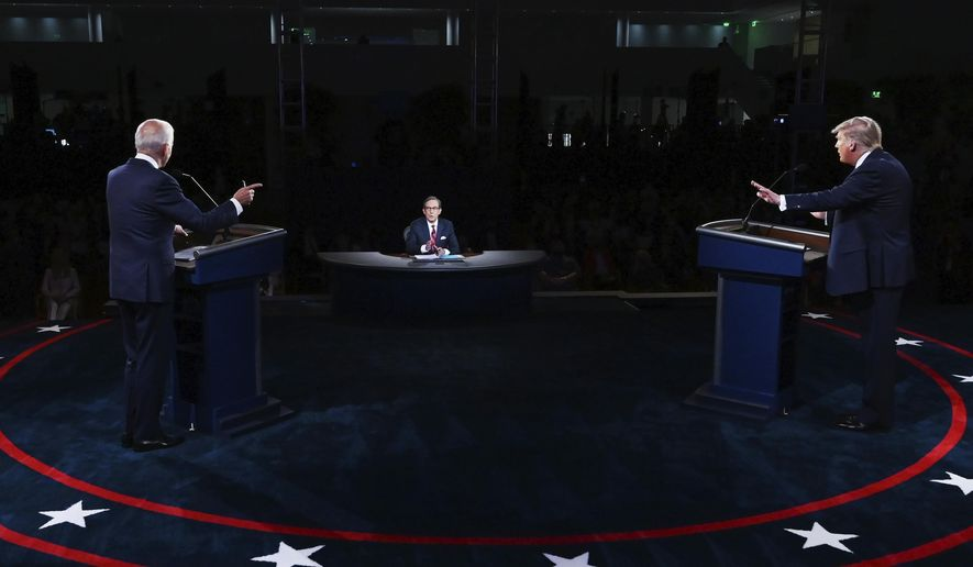 President Donald Trump and Democratic presidential candidate former Vice President Joe Biden participate in the first presidential debate Tuesday, Sept. 29, 2020, at Case Western University and Cleveland Clinic, in Cleveland. (Olivier Douliery/Pool via AP)