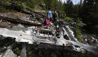 Relatives of members of the 1970 Wichita State University Shockers football team visit the crash site where an airplane carrying some of the players crashed near Loveland Pass Monday, July 27, 2020, west of Silver Plume, Colo. Wreckage from the plane, which was one of two being used to take the Shockers to play a football game against Utah State University in Logan, Utah, is still scattered on the mountain top nearly 50 years after the crash close to the Eisenhower Tunnel. (AP Photo/David Zalubowski)